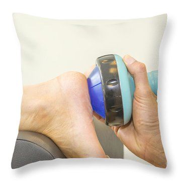 Shockwave Treatment On Foot Sole Throw Pillow