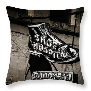 Shoe Hospital Throw Pillow by Phillip Burrow