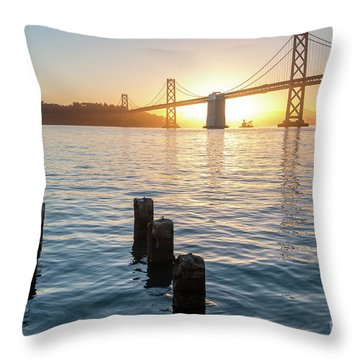 Six Pillars Sticking Out The Water With Bay Bridge In The Backgr Throw Pillow
