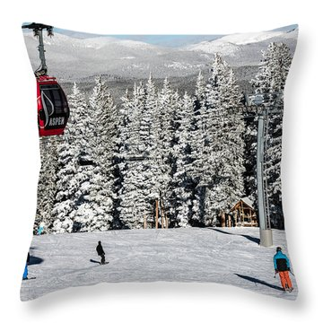 Skiers Limber Up Under A Gondola Near The Summit Of Aspen Mountain Throw Pillow