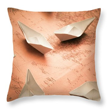 Small Paper Boats On Top Of Old Map Throw Pillow