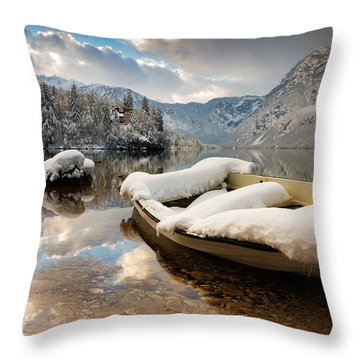 Throw Pillow featuring the photograph Snow Covered Boat On Lake Bohinj In Winter by Ian Middleton
