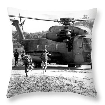 Soldiers Run To A Hh-53c Helicopter Throw Pillow by Stocktrek Images