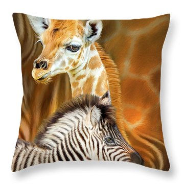 Throw Pillow featuring the mixed media Spots And Stripes - Giraffe And Zebra by Carol Cavalaris
