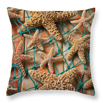 Starfish In Net Throw Pillow by Garry Gay