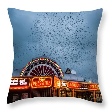 Starlings Over The Neon Lights Of Aberystwyth Pier Throw Pillow