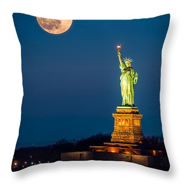 Throw Pillow featuring the photograph Statue Of Liberty And A Rising Supermoon In New York City by Mihai Andritoiu