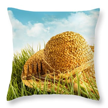 Straw Hat On Grass With Blue Sky  Throw Pillow by Sandra Cunningham