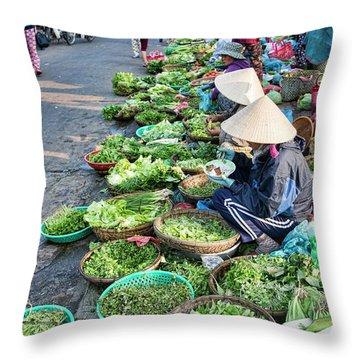 Street Market Hoi An Throw Pillow by Chuck Kuhn