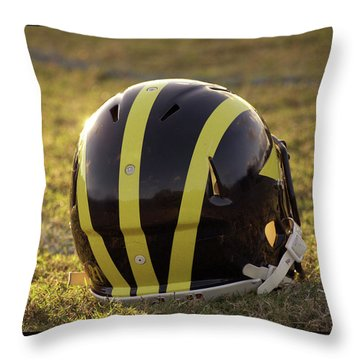 Throw Pillow featuring the photograph Striped Wolverine Helmet On The Field At Dawn by Michigan Helmet