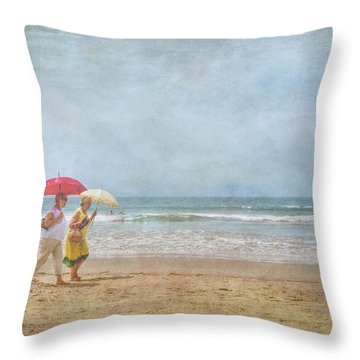 Throw Pillow featuring the photograph Strolling On The Beach by David Zanzinger