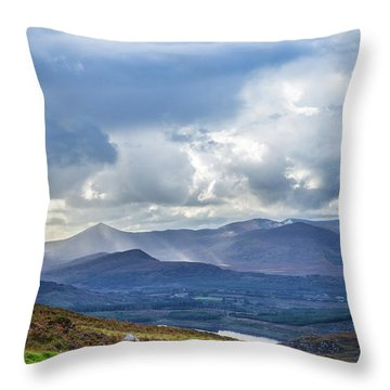 Throw Pillow featuring the photograph Sun Rays Piercing Through The Clouds Touching The Irish Landscap by Semmick Photo