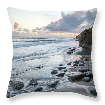 Sunset View In The Distance With Large Rocks On The Beach Throw Pillow