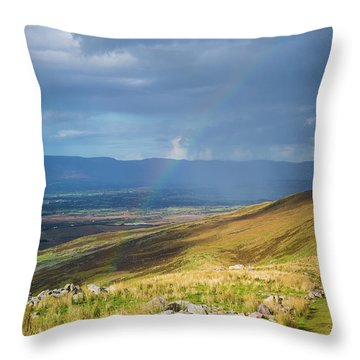 Throw Pillow featuring the photograph Sunshine And Raining Down With Rainbow On The Countryside In Ire by Semmick Photo