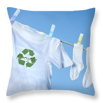 T-shirt With Recycle Logo Drying On Clothesline On A  Summer Day Throw Pillow by Sandra Cunningham