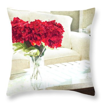 Table With Red Flowers Throw Pillow