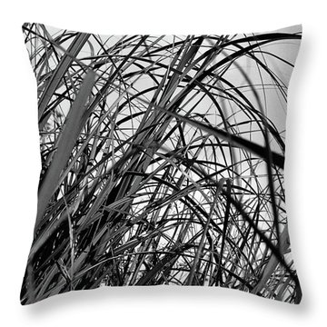 Throw Pillow featuring the photograph Tangled Grass by Susan Capuano