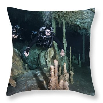 Technical Divers In Dreamgate Cave Throw Pillow by Karen Doody