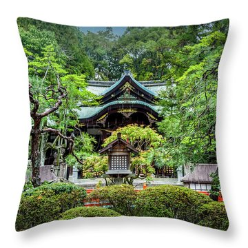 Throw Pillow featuring the photograph Temple In The Rain by Rikk Flohr