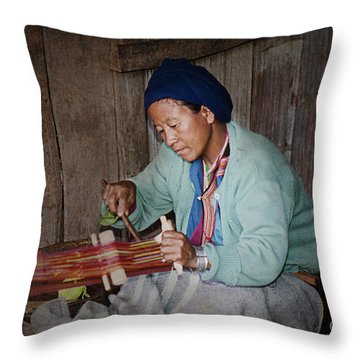 Throw Pillow featuring the photograph Thai Weaving Tradition by Heiko Koehrer-Wagner