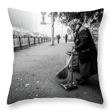 Throw Pillow featuring the photograph The Cleaner Of Leaves by John Williams