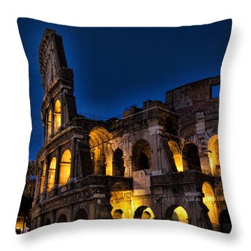 The Coleseum In Rome At Night Throw Pillow by David Smith