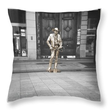 Throw Pillow featuring the photograph The Golden Cowboy by Stwayne Keubrick