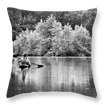 The Kayaker Throw Pillow by Robert Charity