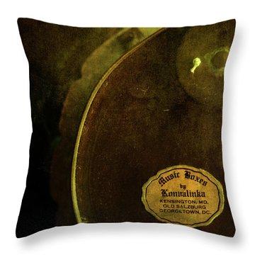 The Konvalinka Music Box Throw Pillow by Rebecca Sherman