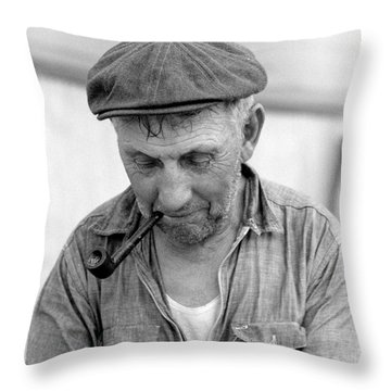 Throw Pillow featuring the photograph The Pipe Smoker by John Stephens
