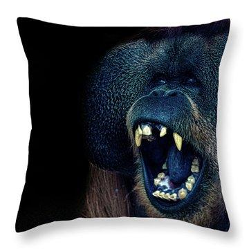 The Laughing Orangutan Throw Pillow by Martin Newman