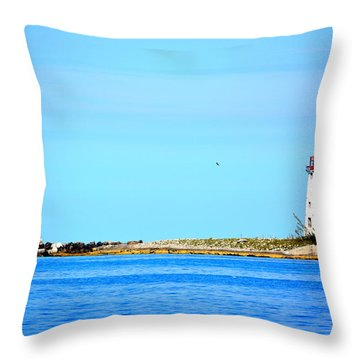The Lighthouse At Sea Throw Pillow