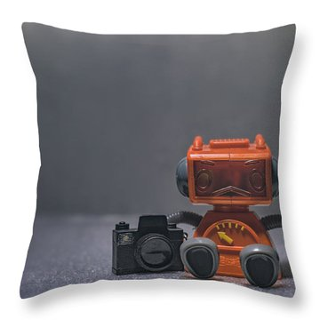 The Lonely Robot Photographer Throw Pillow