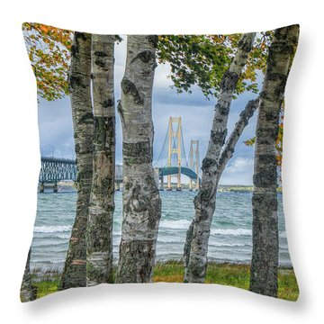 The Mackinaw Bridge By The Straits Of Mackinac In Autumn With Birch Trees Throw Pillow