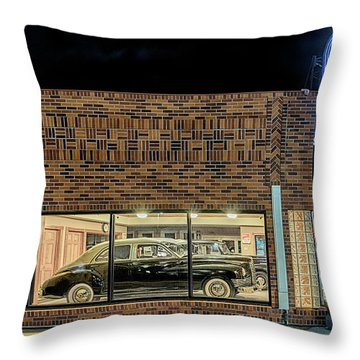 The Old Packard Dealership Throw Pillow