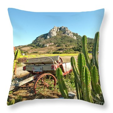 The Old Wagon And Cactus Patch In Front Of One Of The Seven Sisters In San Luis Obispo California Throw Pillow
