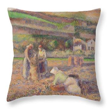 The Potato Harvest Throw Pillow by Camille Pissarro