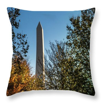 Throw Pillow featuring the photograph The Washington Monument In Fall by Ed Clark