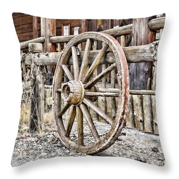 The Wheel Rolls On Throw Pillow