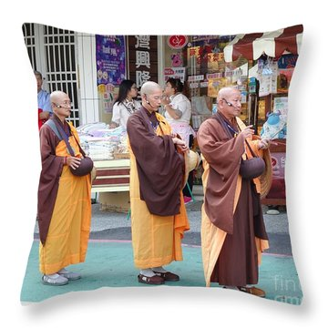 Throw Pillow featuring the photograph Three Buddhist Monks Chant Scriptures by Yali Shi
