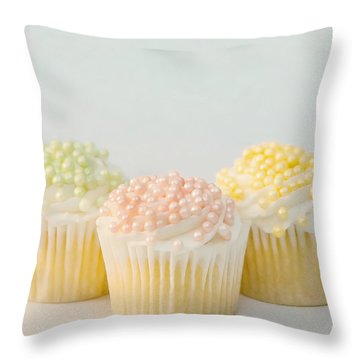 Three Cupcakes Throw Pillow by Art Block Collections