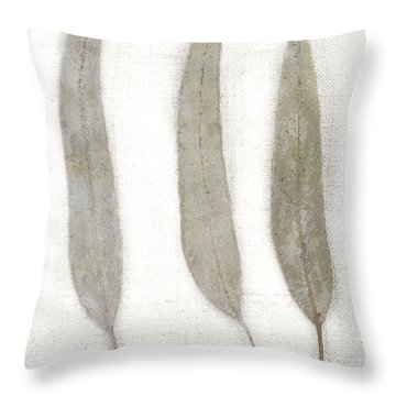 Three Eucalyptus Leaves Throw Pillow by Carol Leigh