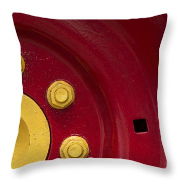Three Yellow Nuts On A Red Wheel Throw Pillow