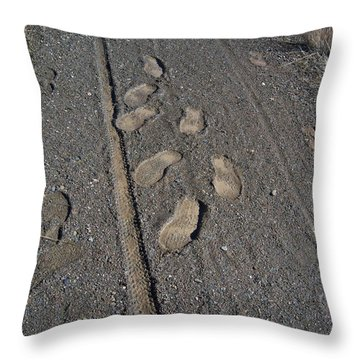 Tire Tracks And Foot Prints Throw Pillow by Heather Kirk