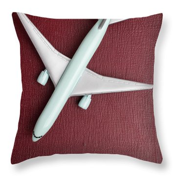 Throw Pillow featuring the photograph Toy Airplane Over Red Book Cover by Edward Fielding