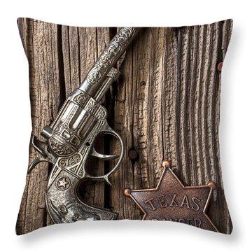 Toy Gun And Ranger Badge Throw Pillow by Garry Gay
