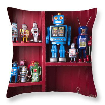 Toy Robots On Shelf  Throw Pillow by Garry Gay