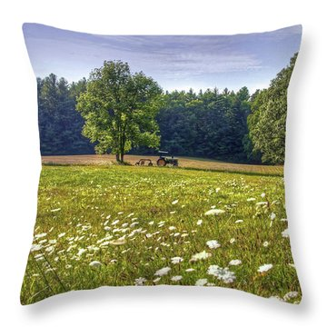 Tractor In Field With Flowers Throw Pillow