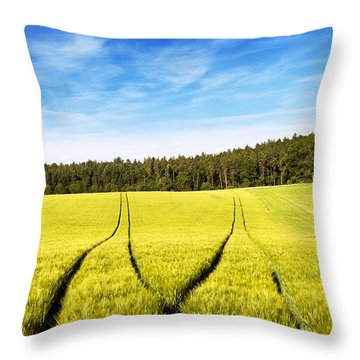 Tractor Tracks In Wheat Field Throw Pillow by Carsten Reisinger