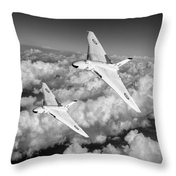 Throw Pillow featuring the photograph Two Avro Vulcan B1 Nuclear Bombers Bw Version by Gary Eason